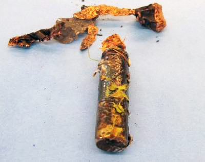An expelled lithium ion battery cell that was fully charged when it burned..